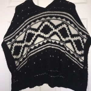Black poncho with white designs
